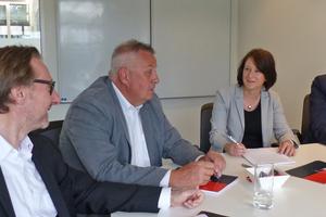 "<span class=""Textmarkierung_rot"">1</span> Michael Hünerlage, Harald Schwab and Klaus Röpke, (left to right) in conversation with Anett Fischer, ZKG International"