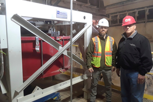 Matthew Thompson and Kenny Miller in front of the Pfister rotor weighfeeder