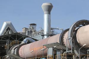 "<div class=""bildtext_en"">The Shargh White Cement plant</div>"