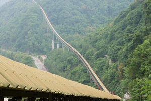 2 Sichuan project: The troughed belt conveyor runs through rough terrain and over instable ground