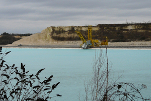 8 (a) The submerged dredging operation at Obourg and (b) exposed bucket chain excavator on land for maintenance purposes