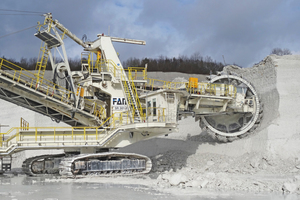 9 The mining operation at Lägerdorf with (a) a bucket wheel excavator up close and (b) from a distance, showing the limitation of the mining method not to separate the inclined dark flint layers