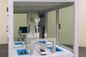 """<div class=""""bildtext_en"""">2 polab Cal – the first automated isothermal calorimeter. In front: the access to calorimeters and robot sample handling; in the back: vial storage and sample reception</div>"""