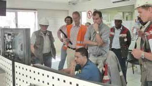 2 Ohorongo employees looking on as the VDZ audit is taking place in the control room at the Sargberg plant<br />