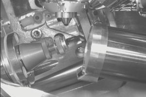 "<span class=""bildunterschrift_hervorgehoben"">8</span>EBSD and FSD detector within the sample chamber of the NanoSEM (on the right, tilted sample left)<br />"
