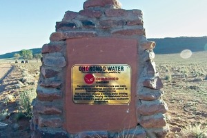 """<div class=""""bildtext_en"""">3 At the beginning of the short road leading to the new waterhole the entrance sign with a donation plaquette was placed </div>"""
