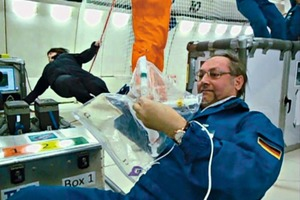 "<div class=""bildtext_en"">4 Prof. Plank conducting an experiment for cement hydration under zero gravity conditions</div>"