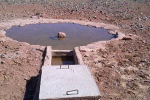 "<div class=""bildtext_en"">1 One of the waterholes which were built</div>"