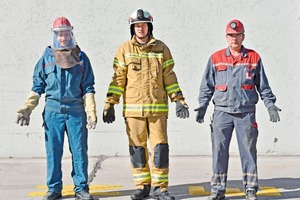 "<div class=""bildtext_en"">5 (left) A complete heat protection suit has to be worn for special work at the preheater, (middle) the personal protection equipment of the works fire brigade and (right) the standard working clothes with safety shoes, protective helmet, safety glasses and safety gloves</div>"