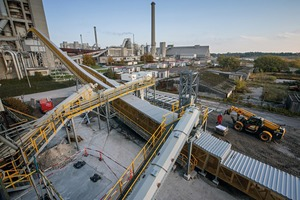 Beumer Group supplied a single-source system to Aalborg Portland to feed the calciner and the main burner with alternative fuels and raw materials. The pipe conveyors are the main component. They are fed via screw conveyors