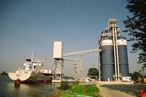 HAVER subsidiary IBAU HAMBURG supplies self-discharging cement-carrying ships, ship loading and unloading terminals, and transshipment and mixing equipment. This photo shows the Brunsbüttel cement terminal located on the Kiel Canal.<br />