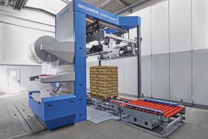 "<div class=""bildtext_en"">2 The Beumer stretch hood covers the full pallets with a thin film hood. The bags arrive safely at their destination and the product is protected against ­humidity and atmospheric influences.</div>"
